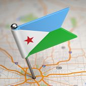 Djibouti Small Flag on a Map Background.