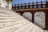 White Marble Steps With Red Stone Balustrade