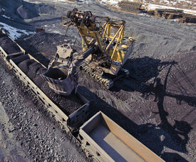 stock photo of iron ore  - loading of iron ore wagons excavated from a warehouse - JPG