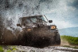 image of four-wheel  - Jeep in mud and dirt splash - JPG