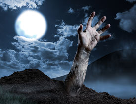 foto of terrific  - Zombie hand coming out of his grave - JPG
