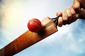 image of british culture  - Cricket batsman hitting a ball shot from below against a blue sky - JPG