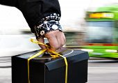 Hand Of Person Carrying Black Box