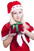 picture of fancy-dress  - Female Santa Claus holding wrapped Christmas Gift with green ribbon wearing fancy dress costume - JPG