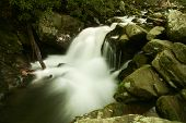 stock photo of smoky mountain  - A waterfall surrounded by rocks - JPG