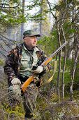 pic of hunter  - Hunter defines the location with the help of the navigator taiga Russia - JPG