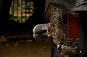 stock photo of rickshaw  - Feet in trainers poking out of rickshaw - JPG