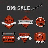 Modern retro red and gray sale labels on textured background