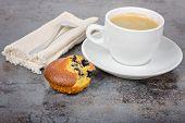 Homemade cupcake and a mug of coffee