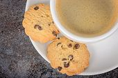 Cup of coffee americano with cookies on table