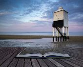 Sunrise Landscape Of Wooden Stilt Lighthouse On Beach In Summer Conceptual Book Image