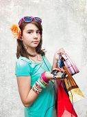 Shopping. Shopping teen girl excited and wondered. Dynamic image of teen girl with shopping bags
