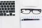 image of field mouse  - Blank business laptop mouse pen glasses and note on white table  - JPG