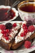 Toast Of Black Bread With Curd Cream And Raspberry, Blackberry And Red Currant.