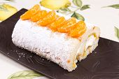 image of satsuma  - Orange flavoured Swiss roll decorated with orange slices