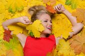 Smiling Woman In Yellow Autumn Maple Leaves