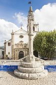 Obidos stone pillory in front of Santa Maria church - Portugal