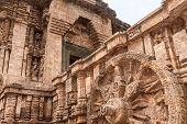 stock photo of chariot  - A chariot wheel carved into the wall of the ancient sun temple of Konark in the state of Orissa - JPG