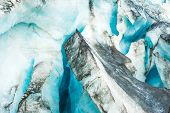 Detailed photo of the Icelandic glacier ice with a incredibly vivid colors and a nice texture