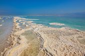 Israel in October. The picturesque path from the evaporated salt in the Dead Sea. Salt formed long paths with scalloped edges