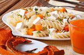 Fusilli Pasta With Feta And Pumpkin Close-up And Juice