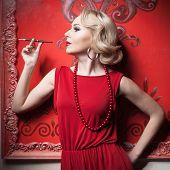Sensual Woman Red Dress Smoking In Vintage Room