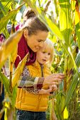 Portrait Of Happy Mother And Child Exploring Cornfield
