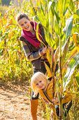 Portrait Of Happy Mother And Child In Cornfield