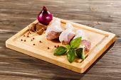 Raw chicken drumsticks on cutting board