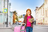 Girl stand alone on the street with city map