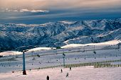 picture of breathtaking  - Breathtaking view of skiers and beautiful mountains at sunset in Valle Nevado - JPG