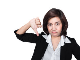 stock photo of disapproval  - Thumbs down businesswoman unhappy and negative giving disapproval hand sign - JPG