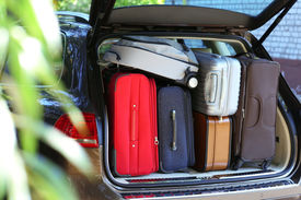 foto of heavy bag  - Suitcases and bags in trunk of car ready to depart for holidays - JPG