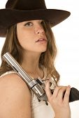 image of pistols  - Tough cowgirl holding large pistol glaring forward - JPG