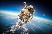 stock photo of surreal  - Astronaut in outer space against the backdrop of the planet earth - JPG