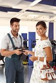 picture of auto repair shop  - Happy attractive caucasian young woman at auto repair business shop - JPG