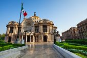 image of mexican  - Palace of fine arts facade and Mexican flag on downtown of Mexico capital city - JPG