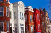 stock photo of row houses  - Colorful residential row houses under bright afternoon sun - JPG