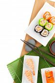 picture of sushi  - Sushi maki and shrimp sushi on bamboo board - JPG