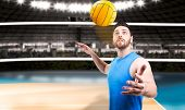 stock photo of volleyball  - Volleyball player on blue uniform on volleyball court - JPG