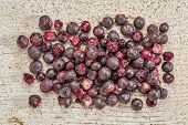 picture of elderberry  - Freeze dried elderberries against rustic barn wood - JPG