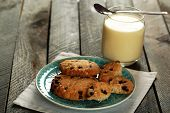 picture of condensation  - Cookies on plate with jar of condensed milk on wooden background - JPG
