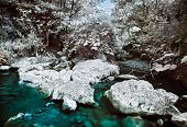 stock photo of irs  - Mountain river with stones infrared  - JPG