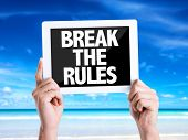 stock photo of misbehaving  - Tablet pc with text Break the Rules with beach background - JPG