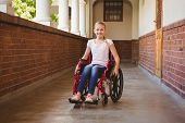 foto of little school girl  - Portrait of cute little girl sitting in wheelchair in school corridor - JPG