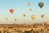 pic of goreme  - Hot air balloons flying over Cappadocia near Goreme at sunrise - JPG