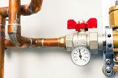 pic of boiler  - temperature gauge indicator with water tap in boiler - JPG