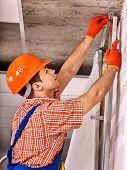 stock photo of millwright  - Happy man in builder uniform indoor - JPG