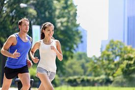 picture of cardio exercise  - Runners jogging in New York City Central Park - JPG