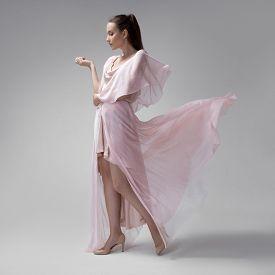 foto of flutter  - Beautiful woman in fluttering airy pink dress - JPG